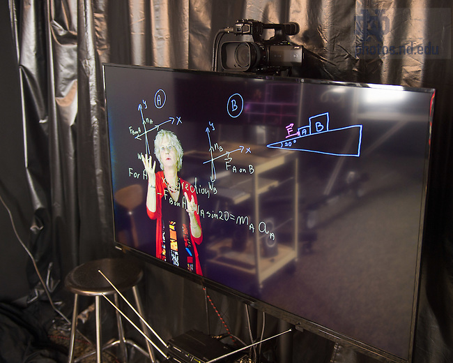 Sept. 8, 2015; Associate Dean and professor of physics Malgorzata (Margaret) Dobrowolksa-Furdyna works at the light board in Jordan Hall of Science. (Photo by Matt Cashore/University of Notre Dame)