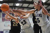 Elkins and Charleston players reach for a rebound, Friday, February 14, 2020 during a basketball game at Elkins High School in Elkins. Check out nwaonline.com/prepbball/ for today's photo gallery.<br /> (NWA Democrat-Gazette/Charlie Kaijo)