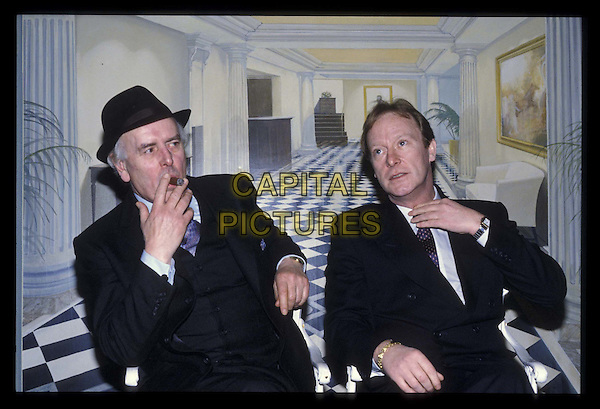 GEORGE COLE & DENNIS WATERMAN.ref:026.smoking, cigar, hat, half length, half-length.*RAW SCAN- photo will be adjusted for publication*.www.capitalpictures.com.sales@capitalpictures.com.©Capital Pictures