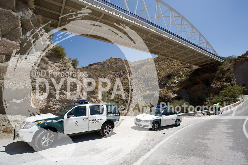 **PICTURES FROM SOLARPIX.COM**<br /> **WORLDWIDE SYNDICATION RIGHTS**<br /> Caption:<br /> A British woman has died bungee jumping in Langaron in Spain while her aunt watched.<br /> Kleyo De Abreu, 23, from London, was killed at around 3pm yesterday in Lanjaron, Granada, Spanish police said.<br /> &quot;She was staying with her aunt for a few days and that relative was present when the tragedy occurred at the Tablate Bridge in the Alpujarras area.<br /> &quot;When emergency services arrived the deceased was still hanging from the rope.<br /> &quot;Although it is too early to draw any conclusions about the circumstances of the death, one of the lines of inquiry is that there was a miscalculation with the rope. &quot;<br /> A Foreign Office spokesman said: &quot;We can confirm the death of a British national in Granada, Spain, yesterday.<br /> &quot;We are liaising with the Spanish authorities and have contacted the family to offer support at this difficult time.&quot;<br /> Tablate Bridge has a drop of 80 metres (262ft) and is a popular bungee jumping site used by several adventure sports firms.<br /> <br /> This pic: GV of The Tablate Bridge where Kleo jumped and hit the Roman bridge Below.Not Blood stains left hand side of bridge.Spanish civil Guard police at the scene<br /> <br /> JOB REF: 18444      AB1       DATE:22.07.15<br /> **MUST CREDIT SOLARPIX.COM OR DOUBLE FEE WILL BE CHARGED**<br /> **MUST NOTIFY SOLARPIX OF ONLINE USAGE**<br /> **CALL US ON: +34 952 811 768 or LOW RATE FROM UK 0844 617 7637**