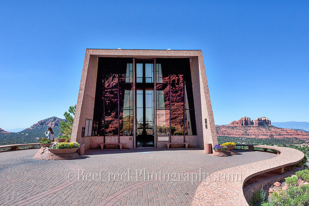 This Chapel in Sedona displays some unique Architecture in that the whole building is built into the side of the mountain.  You can see the reflection of the rocks behind  this.  It has a lovely view of the reds rock from all area the area.