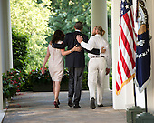 United States President Obama (center) walks with the parents of U.S. Army Sergeant Bowe Bergdahl Jani Bergdahl (left) and Bob Bergdahl (right) back to the Oval Office after making a statement regarding the release of Sgt. Bowe Bergdahl by the Taliban, Saturday May 31, 2014, in the Rose Garden at the White House in Washington, D.C.<br /> Credit: John Harrington / Pool via CNP