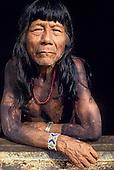 A-Ukre Village, Xingu, Brazil. Tikiri, an elder of the village, with black Genipapo body paint, bead bracelet and watch.