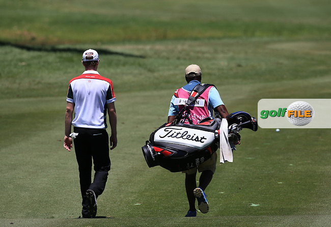 Kevin Phelan (IRL) with Soli on the bag head to the 15th during Round Two of the 2016 Tshwane Open, played at the Pretoria Country Club, Waterkloof, Pretoria, South Africa.  12/02/2016. Picture: Golffile | David Lloyd<br /> <br /> All photos usage must carry mandatory copyright credit (&copy; Golffile | David Lloyd)