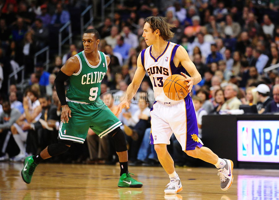 Jan. 28, 2011; Phoenix, AZ, USA; Phoenix Suns guard (13) Steve Nash against Boston Celtics guard (9) Rajon Rondo at the US Airways Center. Mandatory Credit: Mark J. Rebilas-