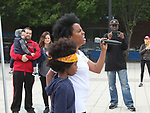 Another World's and singer Rhonda Ross sings the National Anthem with son Raif  - Hearts of Gold 7th Annual Run/Walk for Kids with proceeds from this fun family event will change the futures of homeless mothers and their children on June 3, 2017 at Pier 84 Hudson Parks, New York City, New York. It supports Hearts of Gold Annual Back to School Programs. (Photo by Sue Coflin/Max Photos)