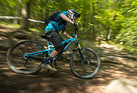 NWA Democrat-Gazette/BEN GOFF @NWABENGOFF<br /> Owen Polumbo races through a tricky slick section Saturday, Aug. 18, 2018, during the Eureka Springs round of the Arkansas Enduro Series at Lake Leatherwood City Park. The event continues Sunday with stages at the Passion Play trails and an urban downhill leg through downtown Eureka Springs. The fifth and final race of the Arkansas Enduro Series season takes place Sept. 22 at the Coler Mountain Bike Preserve in Bentonville. Enduro is a type of mountain bike race with multiple time trial stages that are mostly downhill and technical. The downhill stages are linked together by untimed transition stages or shuttle buses.