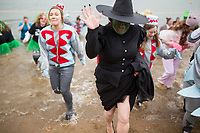 NWA Democrat-Gazette/CHARLIE KAIJO Participants from Mary Mae Jones Elementary race out of freezing cold water during the annual Beaver Lake Polar Plunge, Saturday, February 10, 2018 at the Praire Creek swim area in Rogers.<br />