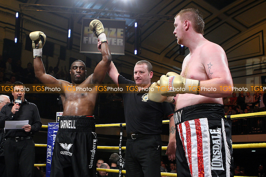 Michael Sprott (black shorts) defeats Danny Hughes - QF4 - Prizefighter 'The Heavyweights IV' Boxing Tournament at York Hall, Bethnal Green, promoted by Matchroom Sports - 09/10/10 - MANDATORY CREDIT: Gavin Ellis/TGSPHOTO - Self billing applies where appropriate - Tel: 0845 094 6026