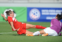 Boyds MD - April 13, 2014: Jodie Taylor (14) of the Washington Spirit goes against  Lydia Williams (1) of the Western New York. The Western New York Flash defeated the Washington Spirit 3-1 in the opening game of the 2014 season of the National Women's Soccer League at the Maryland SoccerPlex.