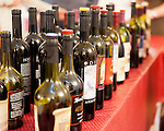 A double row of wines is lined up for tastings at the upstairs overflow tasting bar, in the loft at Horton Vineyards.