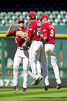 (L-R) Jacob Morris #4, Matt Vinson #20 and Derrick Bleeker #9 celebrate their victory over the Texas Longhorns an at Minute Maid Park on March 4, 2012 in Houston, Texas.  The Razorbacks defeated the Longhorns 7-3.  Brian Westerholt / Four Seam Images