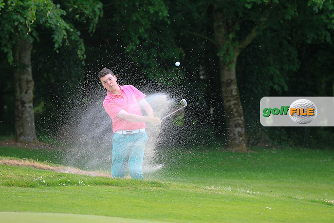 John Corbett Jnr (Thurles) plays out of a bunker onto the 6th green during Round 2 of the Irish Boys Amateur Open Championship at Tuam Golf Club on Wednesday 24th June 2015.<br /> Picture:  Thos Caffrey / www.golffile.ie