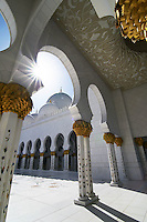 Abu Dhabi Mosque wide angle shot of arcades and sun flare
