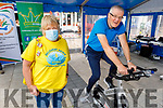 Breda Carmody supporting Dave Elton as Dave is peddling for the Celebrate4Life Stationary Bike-athon fundraiser in Tralee on Friday.