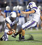 Mascoutah's Logen Timmon (right) kicks as teammate Chase Hanson holds for him. Columbia played Mascoutah on Saturday August 31, 2019 in a football game that was never started on Friday night due to bad storms.<br /> Tim Vizer/Special to STLhighschoolsports.com