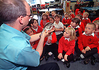 Schoolchildren taking part in a lesson where a teacher has brought different types of fish into class to discuss in the their nature lesson. This image may only be used to portray the subject in a positive manner..©shoutpictures.com..john@shoutpictures.com