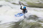Kayak in the world class whitewater of the Lochsa River during spring runoff in Idaho