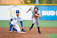 Drew Waters (12) of the Danville Braves takes off for third base as Burlington Royals shortstop Jeison Guzman (13) looks on at Burlington Athletic Stadium on August 12, 2017 in Burlington, North Carolina.  The Braves defeated the Royals 5-3.  (Brian Westerholt/Four Seam Images)