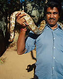 SRI LANKA, Asia, Sigiriya, portrait of snake charmer holding snake around his neck