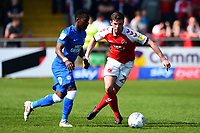Fleetwood Town's Nathan Sheron competes with Peterborough United's Siriki Dembele<br /> <br /> Photographer Richard Martin-Roberts/CameraSport<br /> <br /> The EFL Sky Bet League One - Fleetwood Town v Peterborough United - Friday 19th April 2019 - Highbury Stadium - Fleetwood<br /> <br /> World Copyright © 2019 CameraSport. All rights reserved. 43 Linden Ave. Countesthorpe. Leicester. England. LE8 5PG - Tel: +44 (0) 116 277 4147 - admin@camerasport.com - www.camerasport.com