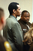 Convicted sniper John Allen Muhammad stands in court as the jury reconvenes after deliberating his fate for almost four hours at the Virginia Beach Circuit Court in Virginia Beach, Virginia on Friday, November 21, 2003.  The jury will decide whether Muhammad will be sentenced to life in prison or death.  The jury will reconvene next week to decide his fate. <br /> Credit: Martin Smith-Rodden - Pool via CNP