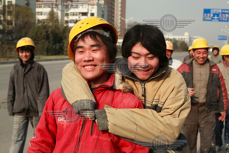 Migrant workers on the streets of Beijing.