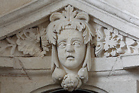 Sculptural detail of a head on a pediment above a door in the King's Apartment, designed in 1664 under Colbert during the reign of King Louis XIV, on the first floor of the Phare de Cordouan or Cordouan Lighthouse, built 1584-1611 in Renaissance style by Louis de Foix, 1530-1604, French architect, located 7km at sea, near the mouth of the Gironde estuary, Aquitaine, France. This is the oldest lighthouse in France. There are 4 storeys, with keeper apartments and an entrance hall, King's apartments, chapel, secondary lantern and the lantern at the top at 68m. Parabolic lamps and lenses were added in the 18th and 19th centuries. The lighthouse is listed as a historic monument. Picture by Manuel Cohen