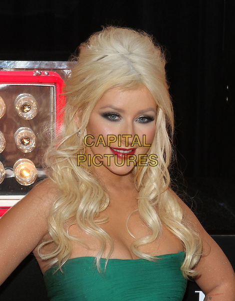 CHRISTINA AGUILERA.'Burlesque' Los Angeles Premiere held at The Grauman Chinese Theatre, Hollywood, CA, USA. .November 15th, 2010.headshot portrait wavy hair make-up red lipstick beauty cleavage eyeshadow strapless green .CAP/ADM/KB.©Kevan Brooks/AdMedia/Capital Pictures.