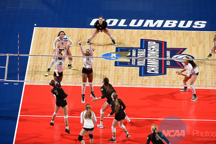 COLUMBUS, OH - DECEMBER 17:  Ivana Vanjak (7) of Stanford University hits a dink over Chloe Collins (21) and Morgan Johnson (12) of the University of Texas during the Division I Women's Volleyball Championship held at Nationwide Arena on December 17, 2016 in Columbus, Ohio.  Stanford defeated Texas 3-1 to win the national title. (Photo by Jamie Schwaberow/NCAA Photos via Getty Images)