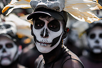 A Mexican man, wearing a skull mask and having his face painted with Calaca theme, performs on the street during the Day of the Dead festival in Mexico City, Mexico, 29 October 2016. Day of the Dead (Día de Muertos), a syncretic religious holiday combining the death veneration rituals of the ancient Aztec culture with the Catholic practice, is celebrated throughout all Mexico. Based on the belief that the souls of the departed may come back to this world on that day, people gather at the gravesites in cemeteries praying, drinking and playing music, to joyfully remember friends or family members who have died and to support their souls on the spiritual journey.