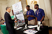 United States President Barack Obama  looks at a rocket created by Wooddale High School's students Wesley Carter and Darius Hooker from Memphis, Tennessee in the State Dining Room of the White House in Washington, D.C. at the White House Science Fair on April 22, 2013. The White House Science Fair celebrates the student winners of a broad range of science, technology, engineering and math (STEM) competitions from across the country. The first White House Science Fair was held in late 2010.<br /> Credit: Aude Guerrucci / Pool via CNP