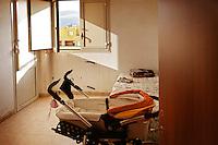 Palermo,interiors in Zen district, the bedroom of a young couple with a baby. <br /> Palermo, interni di una casa nel quartiere Zen occupata da una giovane coppia con bambino.