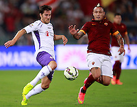 Calcio, Serie A: Roma vs Fiorentina. Roma, stadio Olimpico, 30 agosto 2014.<br /> Fiorentina midfielder Joshua Brillante, of Australia, left, and Roma midfielder Radja Nainggolan, of Belgium, fight for the ball during the Italian Serie A football match between AS Roma and Fiorentina at Rome's Olympic stadium, 30 August 2014.<br /> UPDATE IMAGES PRESS/Isabella Bonotto