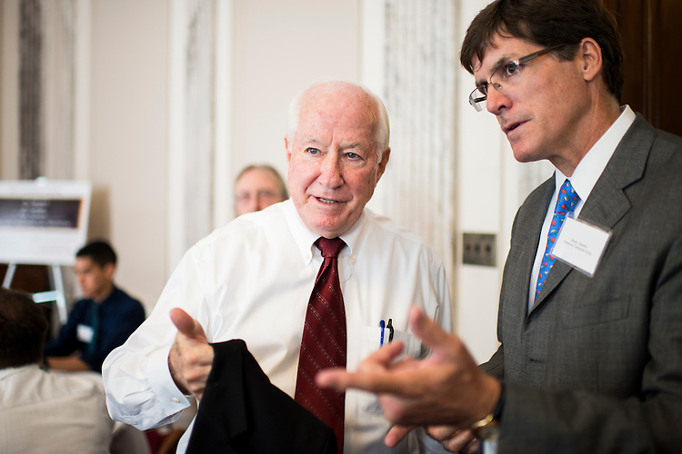 UNITED STATES - JULY 22: From left, former Rep. Jim Kolbe, R-Ariz., honorary co-chair of the Dollar Coin Alliance, speaks with Shawn Smeallie,  of the American Continental Group and the Dollar Coin Alliance, as he arrives for the Council for Citizens Against Government Waste and the Dollar Coin Alliance briefing on the dollar coin in the Russell Senate Office Building on Monday, July 22, 2013. (Photo By Bill Clark/CQ Roll Call)
