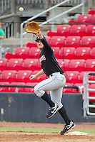 Ian Gac #33 of the Kannapolis Intimidators stretches for a throw at first base against the Hickory Crawdads at  L.P. Frans Stadium August 1, 2010, in Hickory, North Carolina.  Photo by Brian Westerholt / Four Seam Images