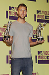 LOS ANGELES, CA - SEPTEMBER 06: DJ Calvin Harris  poses in the press room during the 2012 MTV Video Music Awards at Staples Center on September 6, 2012 in Los Angeles, California.