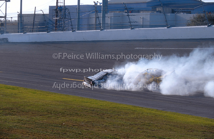 Dale Earnhardt Crash Frame 5.The cars of Earnhardt (L) and Schrader slide off the banking..NASCAR Winston Cup Daytona 500 18 Feb.2001 Daytona International Speedway, Daytona Beach,Florida,USA .© F. Peirce Williams .photography 2001...F.Peirce Williams Photography.P.Box 455 Eaton, OH 45320.317.358.7326  fpwp@mac.com