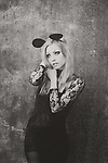 black-white photo of young woman with blonde hair wearing a black lace dress and wearing mouse ears