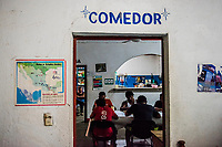 ARRIAGA, MEXICO - NOVEMBER 07: MIgrants eat their dinner at a migrant shelter a night before leaving Arriaga for the walk to Chahuites and further North on the 7th of November, 2015 in Arriaga, Mexico. <br /> Daniel Berehulak for The New York Times
