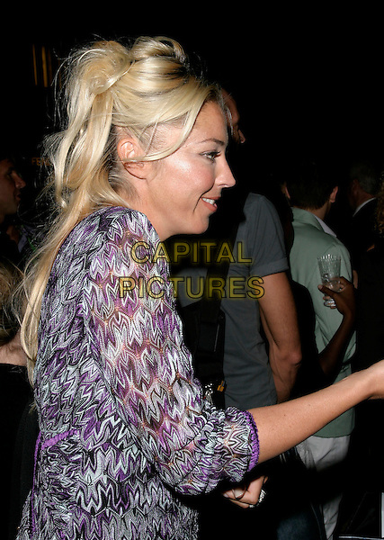 TAMARA BECKWITH.Launch party for the 21st anniversary issue of Elle Magazine at the Versace Store in Sloane Street, London, UK..September 7th, 2006.Ref: AH.half length purple pattern dress profile.www.capitalpictures.com.sales@capitalpictures.com.©Adam Houghton/Capital Pictures.