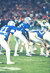 Bosco/Smith,Kelly-84bowl<br /> <br /> 6 Robbie Bosco. 21 Kelly Smith. 50 Trevor Matich. Holiday Bowl vs Michigan<br /> <br /> December 21, 1984<br /> <br /> Photo by Mark Philbrick/BYU<br /> <br /> &copy; BYU PHOTO 2009<br /> All Rights Reserved<br /> photo@byu.edu  (801)422-7322