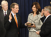 Washington, D.C. - May 17, 2005 --  Rob Portman is sworn-in as United States Trade Representative (USTR) at the Eisenhower Executive Office Building adjacent to the White House in Washington, D.C., May 17, 2005. White House Chief of Staff Andrew Card (R) administers the oath of office while spouse Jane Portman holds the bible while looking on is his father Bill.<br /> Credit: Mannie Garcia - Pool via CNP