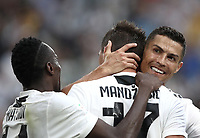 Calcio, Serie A: Juventus - Lazio, Torino, Allianz Stadium, 25 agosto, 2018.<br /> Juventus' Mario Mandzukic (c) celebrates after scoring with his teammates Cristiano Ronaldo (r) and Blaise Matuidi (l) during the Italian Serie A football match between Juventus and Lazio at Torino's Allianz stadium, August 25, 2018.<br /> UPDATE IMAGES PRESS/Isabella Bonotto