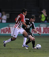 DC United defender Marc Burch (4) shields the ball against Chivas USA midfielder Jesus Padilla (10).  Chivas USA defeated DC United 2-0  at RFK Stadium, Saturday October 3, 2009.