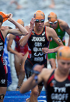 12 JUL 2014 - HAMBURG, GER - Helen Jenkins (GBR) of Great Britain heads for transition at the end of the swim at the elite women's 2014 ITU World Triathlon Series round in the Altstadt Quarter, Hamburg, Germany (PHOTO COPYRIGHT © 2014 NIGEL FARROW, ALL RIGHTS RESERVED)