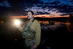 Hunter Jeff Bannister, of Greenville, looks for the glowing red eyes of alligators during a hunt along the Cooper River Oct. 5, 2008 in Moncks Corner, South Carolina. After 40 years, the Department of Natural Resources (DNR) issued 1,000 permits to hunt alligators in South Carolina in an effort to control the population which numbers more than 100,000. (Paul Zoeller/pressphotointl.com)