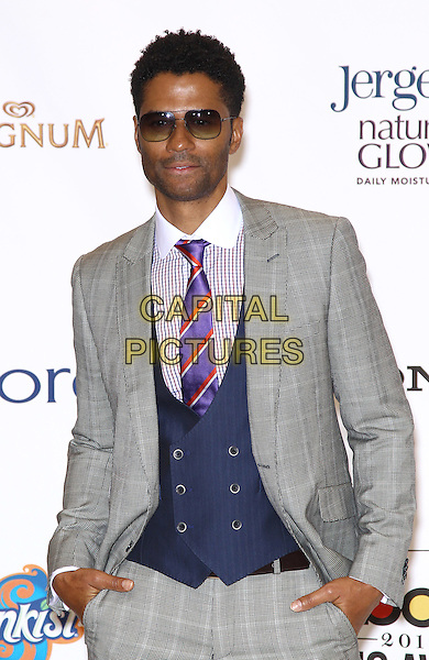 Eric Benet.2012 Billboard Music Awards Press Room at the MGM Grand Garden Arena Las Vegas, Las Vegas, Nevada, USA..May 20th, 2012.half length grey gray suit purple tie shirt sunglasses shades .CAP/ADM/MJT.© MJT/AdMedia/Capital Pictures.
