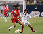 21 June 2007:  Guadeloupe's Stephane Auvray (8), marked by Mexico's Gerardo Torrado (6). The National Team of Mexico defeated Guadeloupe 1-0  in a CONCACAF Gold Cup Semifinal match at Soldier Field in Chicago, Illinois.