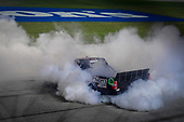 #16: Brett Moffitt, Hattori Racing Enterprises, Toyota Tundra celebrates after winning with a burnout
